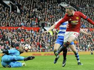 Rooney equals club record as Man Utd flogs Reading