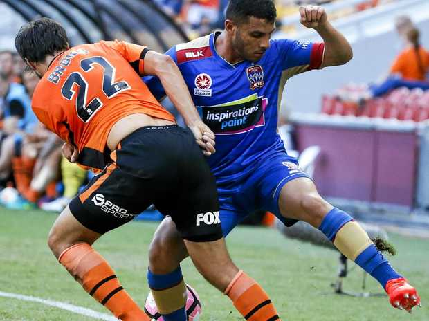 Thomas Broich of the Roar competes for possession with Andrew Nabbout of the Jets at Suncorp Stadium.