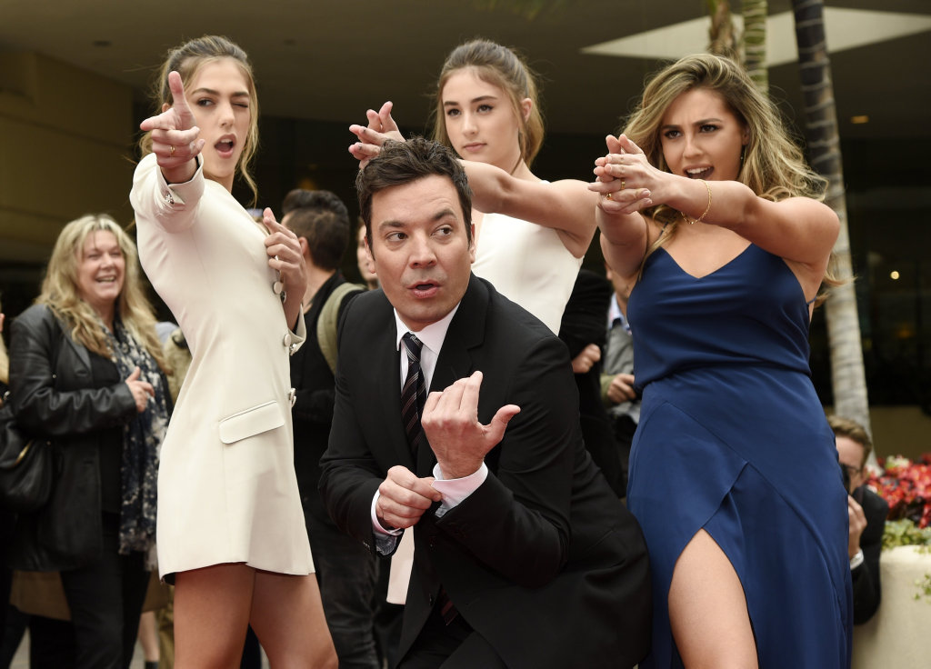 Jimmy Fallon, host of the 74th Annual Golden Globe Awards, poses with Miss Golden Globes 2017, from left, sisters Sistine, Scarlet and Sophia Stallone after rolling out the red carpet during Golden Globe Awards Preview Day at the Beverly Hilton on Wednesday, Jan. 4, 2017, in Beverly Hills, Calif.