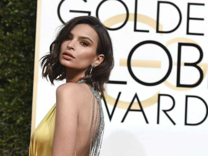 Emily Ratajkowski arrives at the 74th annual Golden Globe Awards at the Beverly Hilton Hotel on Sunday, Jan. 8, 2017, in Beverly Hills, Calif.
