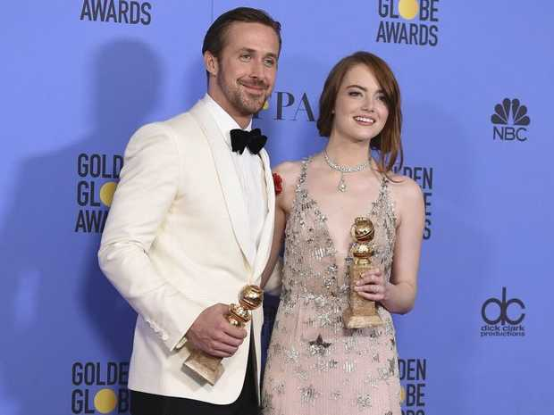 Ryan Gosling, left, and Emma Stone pose in the press room with the award for best performance by an actor and actress in a motion picture - musical or comedy for La La Land at the 74th annual Golden Globe Awards.