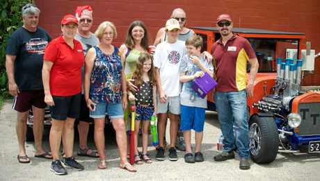 The organisers of the car meet with Ziggy and his family, who were very grateful for the donation.