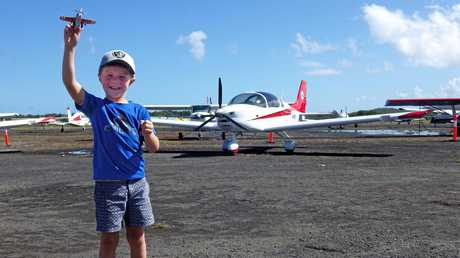 Bailey Skinner, 6, from Tweed Heads with his toy plane.