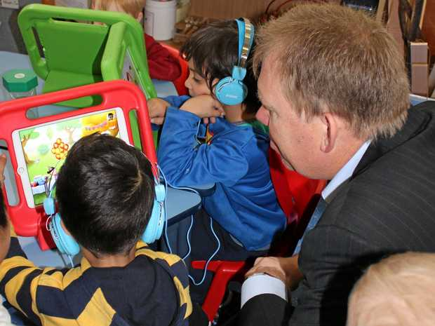 Children learning another language through the ELLA program.