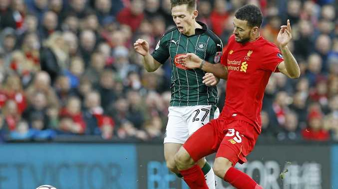 Liverpool's Kevin Stewart, right, and Plymouth Argyle's Craig Tanner battle for the ball.