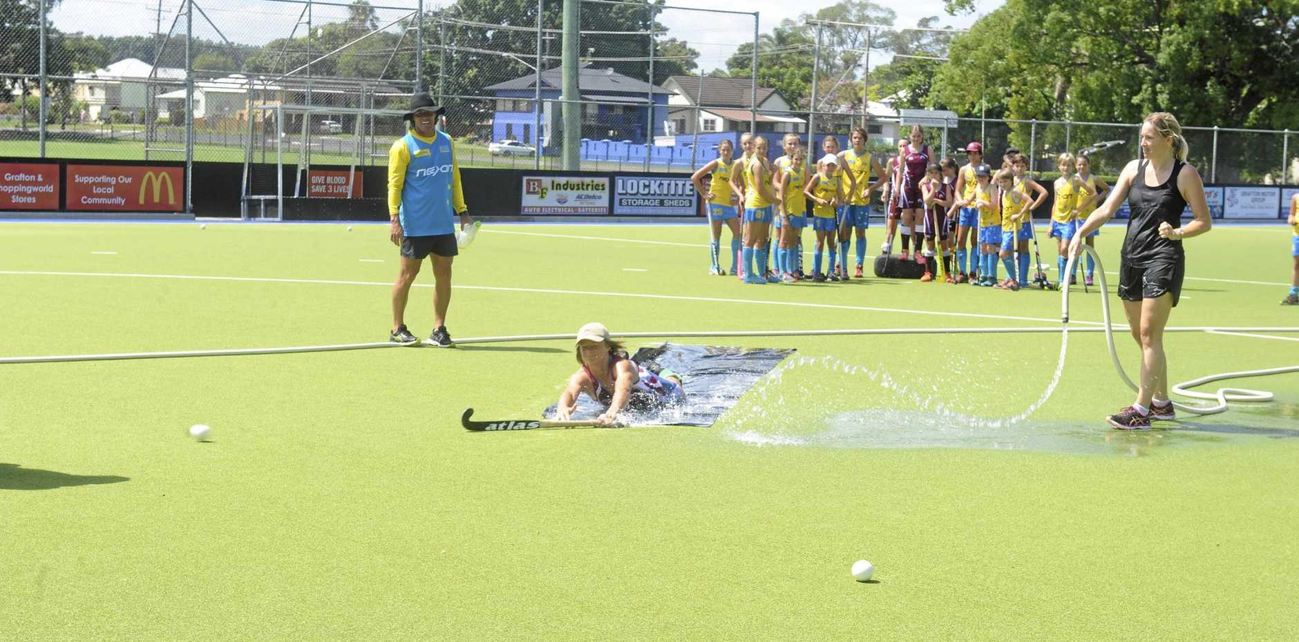 LEARNING EXPERIENCE: Brent Livermore watches on as junior hockey players from Grafton and the Gold Coast take part in the Brent Livermore Rising Stars camp.