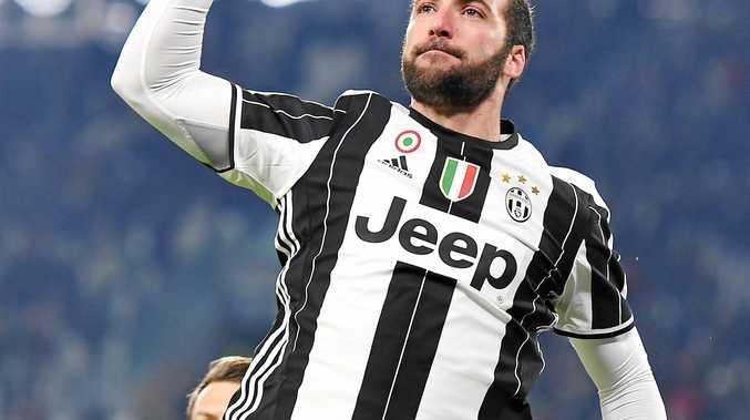 Juventus striker Gonzalo Higuain celebrates after scoring.