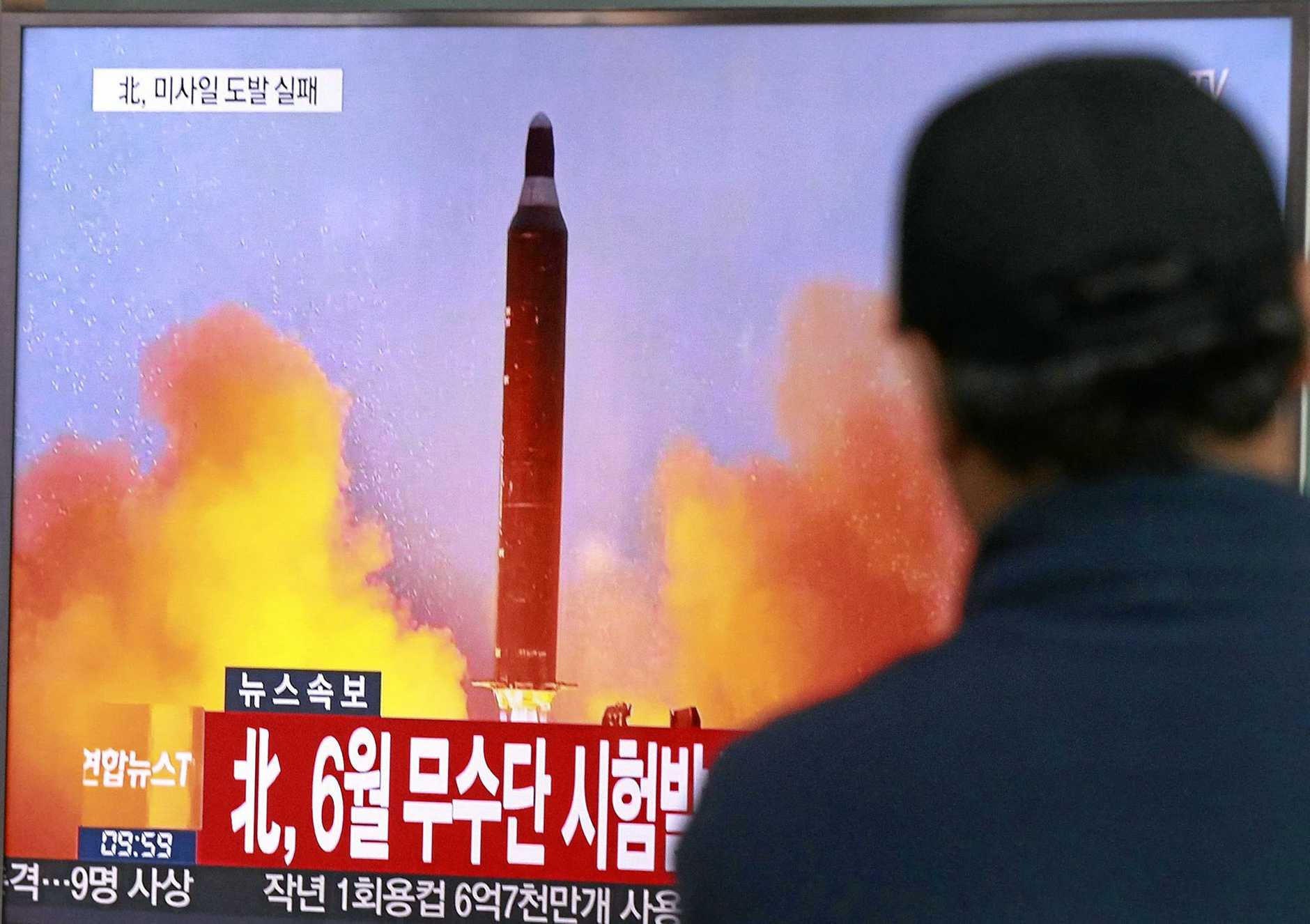 On October 16 last year, a man watches a TV news program showing a file image of a missile launch conducted by North Korea, at the Seoul Railway Station in Seoul, South Korea.