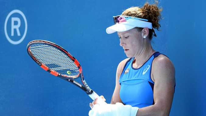 Samantha Stosur wipes her raquete between points during their first round match against Anastasia Pavlyuchenkova of Russia at the Sydney International