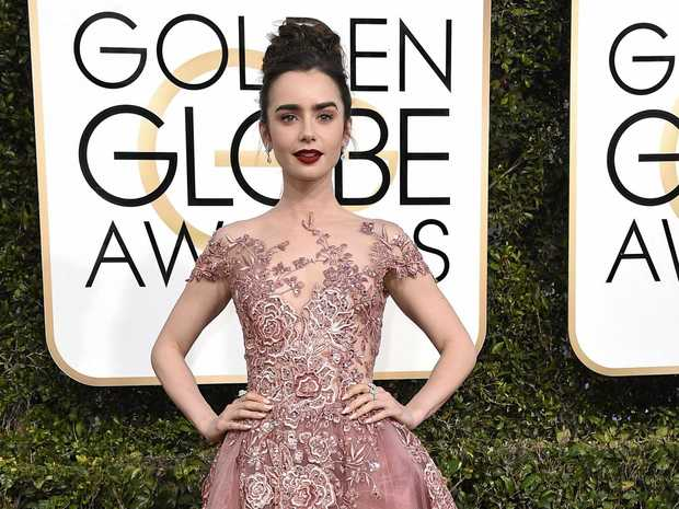 Lily Collins' rose-coloured gown is spectacular.