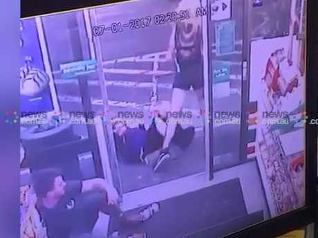 The woman steps over Ms Hacker with the axe and leaves the 7-Eleven premises while Ben Rimmer sits stunned in his own blood on the shop floor.