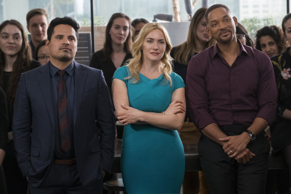 Michael Pena, Kate Winslet and Will Smith in a scene from the movie Collateral Beauty.