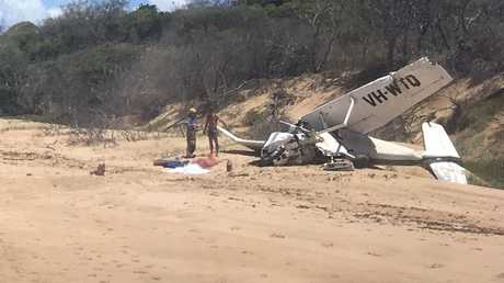 WRECKAGE: One person has died and three hospitalised after a light plane crashed at Bustard Head, north of Middle Island.Photo Courtesy RACQ LifeFlight RescuePhoto Contributed