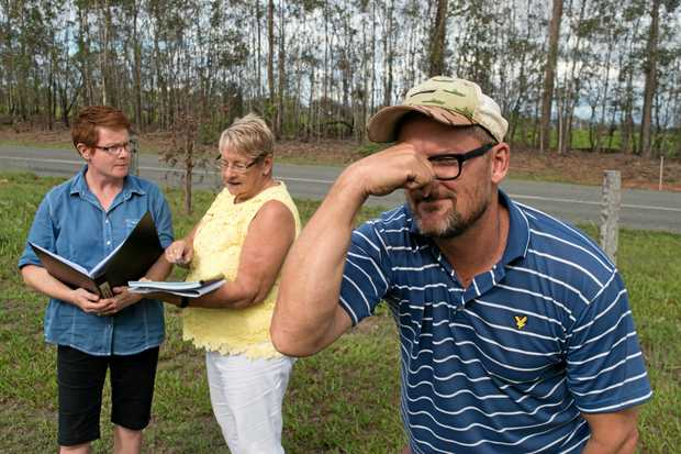 NOT EGGSELENT: Spring Creek Orchids farmer Fergus Tweedy (front) along with neighbours Tina Cupitt (left) and Merle Bonell, aren't looking forward to the possibility of poultry sheds on Gatton Esk Road.
