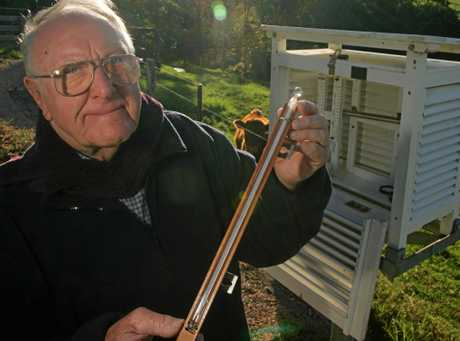 WEATHER MAN: Maleny's Patrick Stacey checks the chilly temperature at his home weather station.