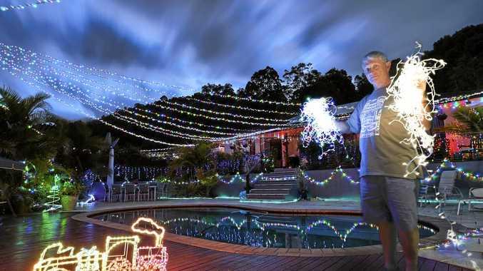 David White shows off his Christmas lights display