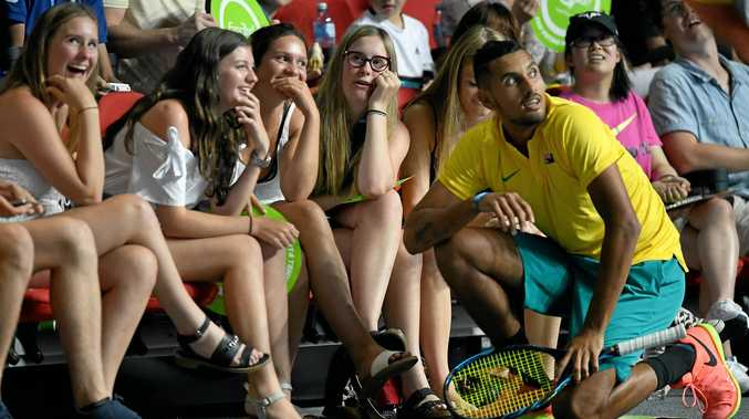 GREAT WITH FANS: Nick Kyrgios mixes with spectators while waiting for a challenge decision during the Sydney Fast 4 exhibition.