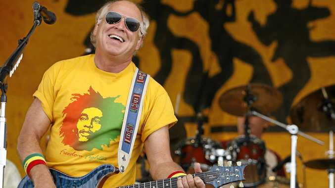 Jimmy Buffett performs during the 2006 New Orleans Jazz and Heritage Festival in New Orleans on Saturday, May 6, 2006. (AP Photo/Alex Brandon)