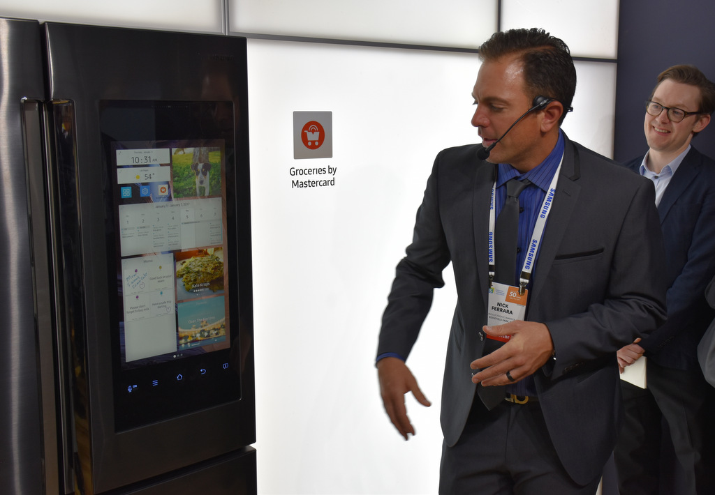 A Samsung representative demonstrates Family Hub 2.0 - the new fridge with voice control - at CES 2017 in Las Vegas.