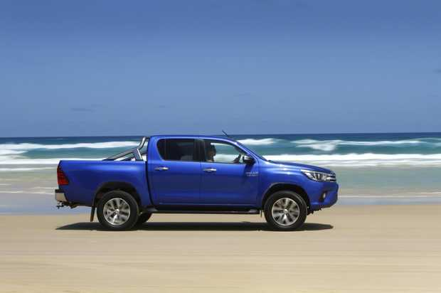 BEACH BASHING: HiLux SR5 in its element along Teewah Beach at Noosa North Shore as part of our long-term test of the best-selling Toyota 4x4 ute