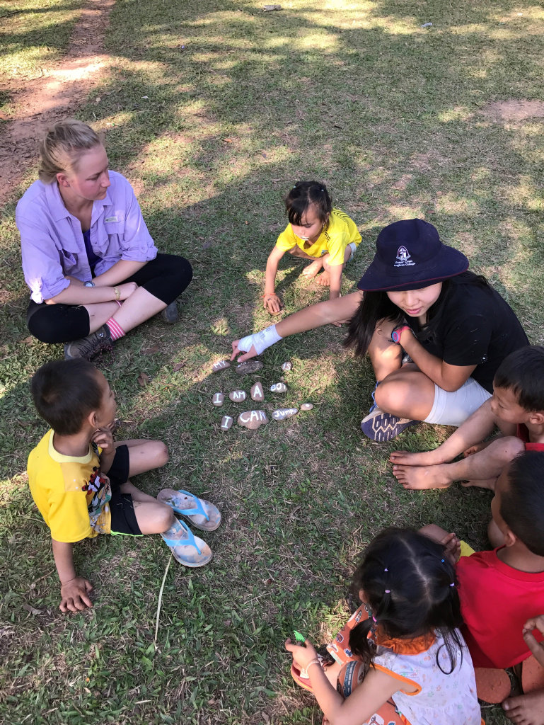 Fraser Coast Anglican College students helping young children in Laos learn English.
