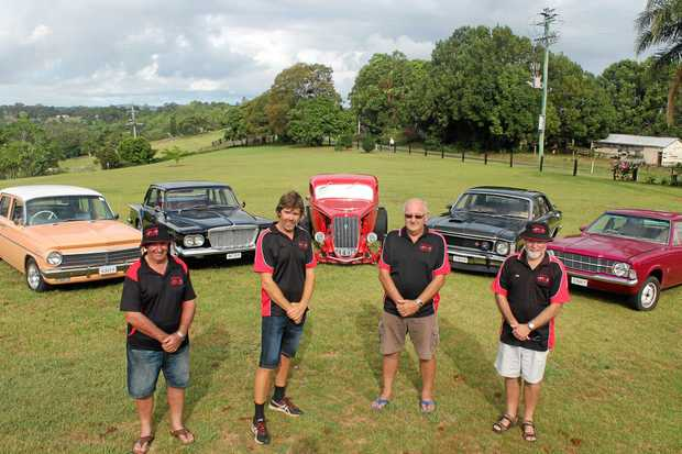 BOYS TOYS: Members of the North Coast Street Machines (from left) Errol Beaumont, Steven Fitness, Les Eckersley and John Stanford are ready for this Sunday's show and shine in Ballina, with their vehicles (from left) 1964 EH Holden, 1962 S Series Valiant, 1934 Ford, 1969 XW GT Falcon and a 1974 L Cortina.