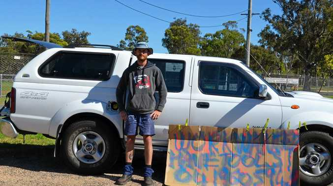 Unemployed Stanthorpe man Martyn Skinner took his job search to a new level, making a sign and hoping a passing driver could help.
