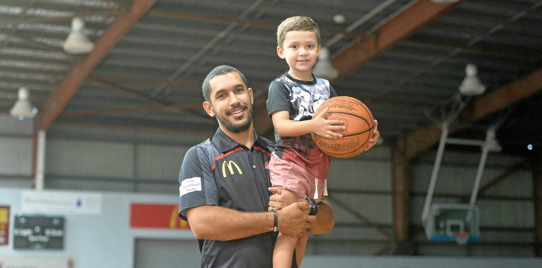 BACK ON BOARD: Mackay McDonald's Meteors captain Chris Cedar with four-year-old son Jake.