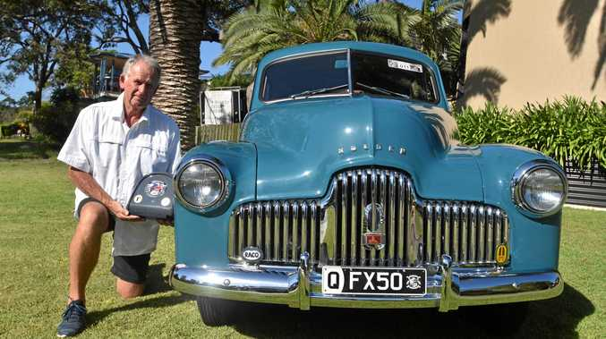 Proud car owner Paul Connolly shows off his trophy and the FX Holden that won it for him.