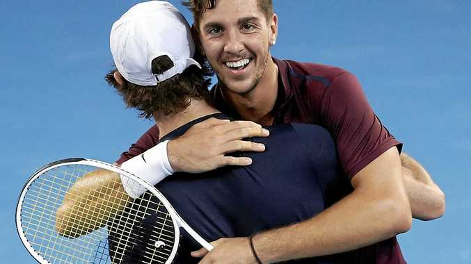 Australian's Jordan Thompson (left) and Thanasi Kokkinakis celebrate after winning the final of the Men's doubles match against Gilles Muller of Luxembourg and Sam Querrey of USA at the Brisbane International Tennis Tournament in Brisbane, Sunday, Jan. 08, 2017. (AAP Image/Dave Hunt) NO ARCHIVING, EDITORIAL USE ONLY