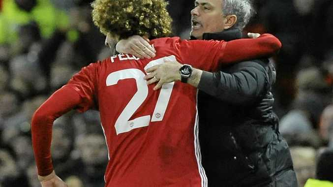 Manchester United's manager Jose Mourinho, right, hugs Marouane Fellaini after he scored in the EFL Cup semi-final.