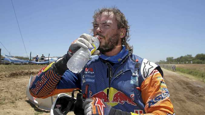 Australia's KTM motorbike driver Toby Price drinks water after finishing the second stage of the Dakar Rally, between Resistencia and San Miguel de Tucuman, Argentina, Tuesday, Jan. 3, 2017. The race started in Paraguay and will pass through Bolivia as well. (AP Photo/Martin Mejia)