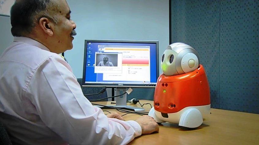 La Trobe University's Professor Rajiv Khosla with the robot, Matilda.