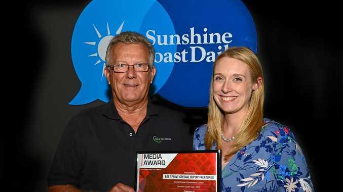 AWARD WINNER: Greg Beale congratulates Sunshine Coast Daily editor-in-chief Jenna Cairney.