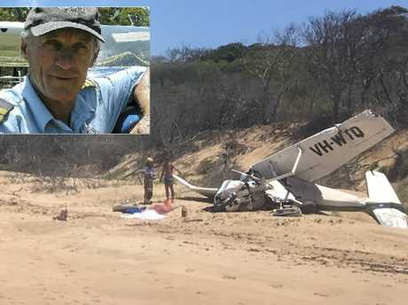 "1770 Castaway owner Bruce Rhoades has hailed his ""best mate"" Les 'Woody' Woodall a hero after the plane he was flying crashed into the sand at Middle Island."