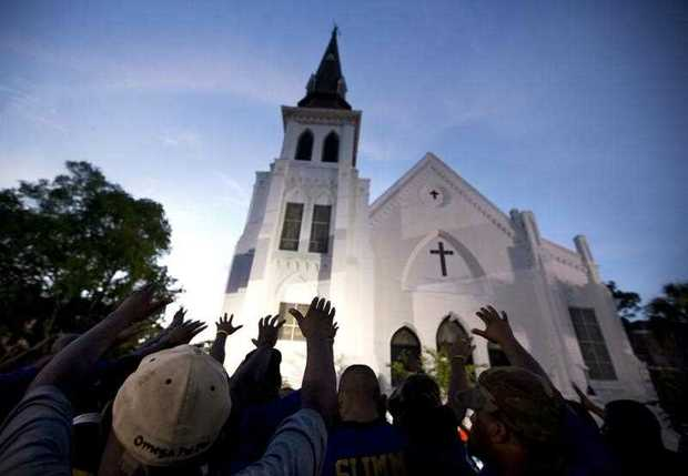 A crowd of people in prayer outside the Emanuel AME Church, after a memorial for the nine people killed by Dylann Roof in Charleston, S.C. A federal jury will consider whether Roof should be sentenced to death or life in prison for the racially motivated attack