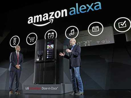 LG Electronics' vice president David VanderWaal and Amazon Echo vice president Mike George present the LG Smart InstaView Door-in-Door Refrigerator to CES 2017 attendees Featuring InstaView technology and a smart touchscreen enabled with Amazon Alexa, users can simply knock twice to see what's inside.