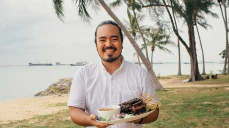 Adam Liaw with his beef satay in a scene from Destination Flavour Singapore.