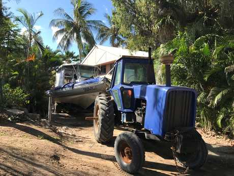 Yongala Dive uses a tractor to launch its boat from the beach to take divers to the wreck of the SS Yongala.