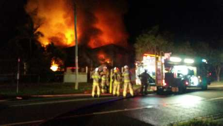Fire crews work to put out the blaze which engulfed a Queenslander in Granville.