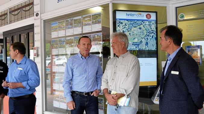 Former Prime Minister Tony Abbott greeted shop owners as he walked through Cooroy.