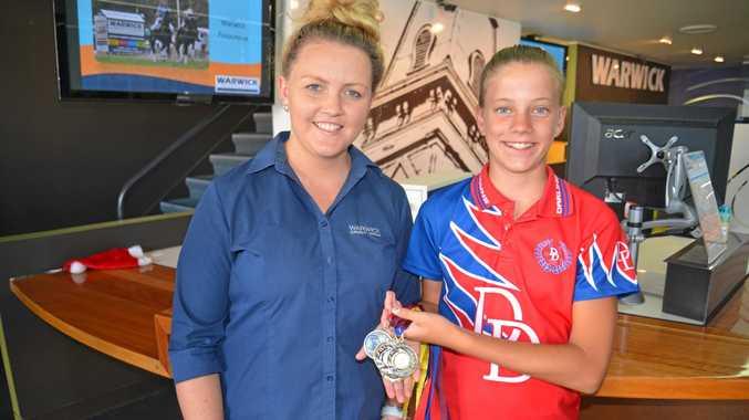 SUPERSTAR: WCU customer service officer Chikera Bray with monthly junior sports star winner Madi Balloch.