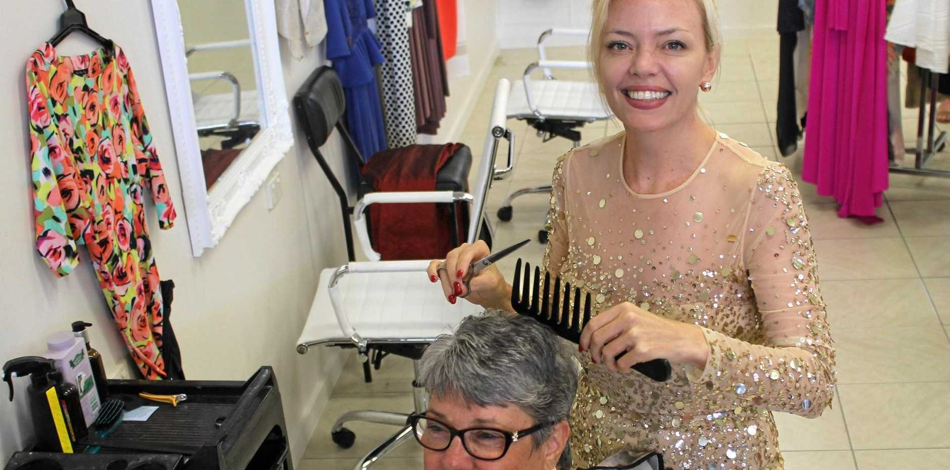 Hello Beautiful owner Josephine Potter gives regular customer Bronwyn Higgins a haircut.