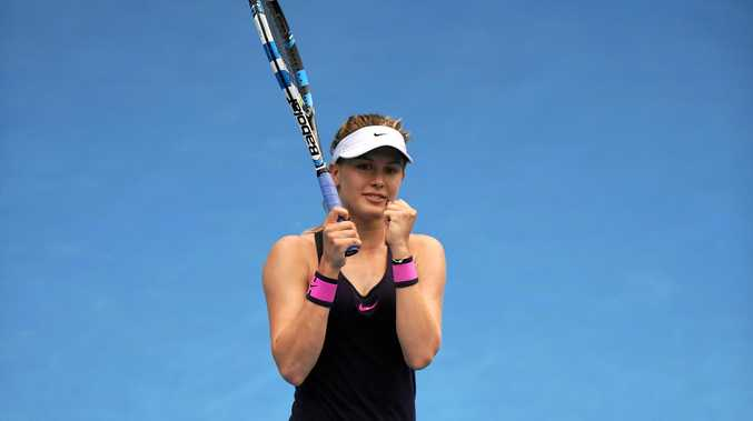 Eugenie Bouchard of Canada celebrates her win over Anastasia Pavlyuchenkova of Russia at the Sydney International