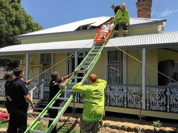 A man in his 70s was rescued from an Allora home after a hip injury left him stuck in the ceiling of the house.