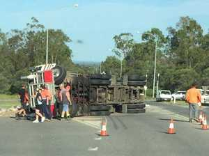 Road closed until midday after truck and trailer rollover