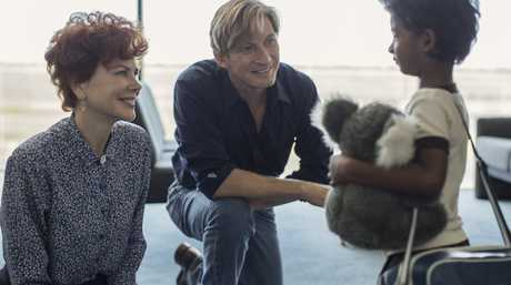 Nicole Kidman, David Wenham and Sunny Pawar in a scene from the movie Lion.
