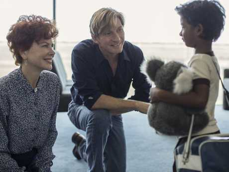 Nicole Kidman, David Wenham and Sunny Pawar in a scene from the movie Lion.