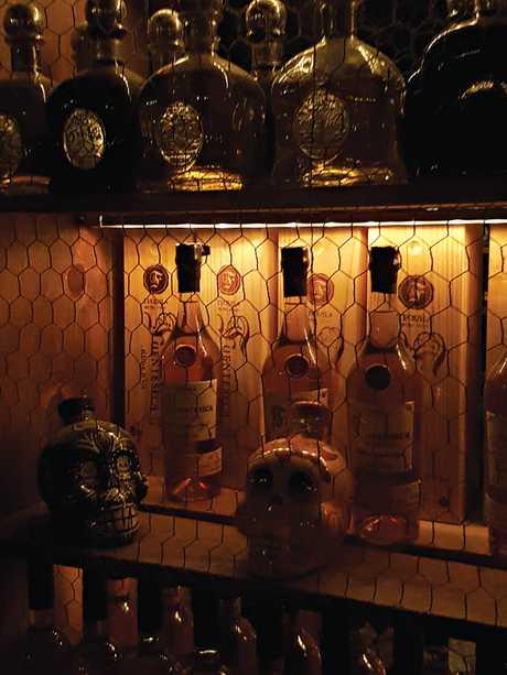 Tequila bottles inside La Esquina.