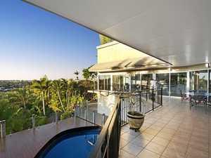 Designer home set in lush tropical gardens